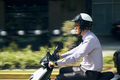 Chinese Businessman Commuter Riding Scooter Motorcycle In City - PhotoDune Item for Sale
