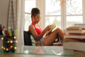 African American Woman Reading Book At Home Near Window - PhotoDune Item for Sale