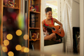 Black Woman Singing And Playing Guitar At Home - PhotoDune Item for Sale