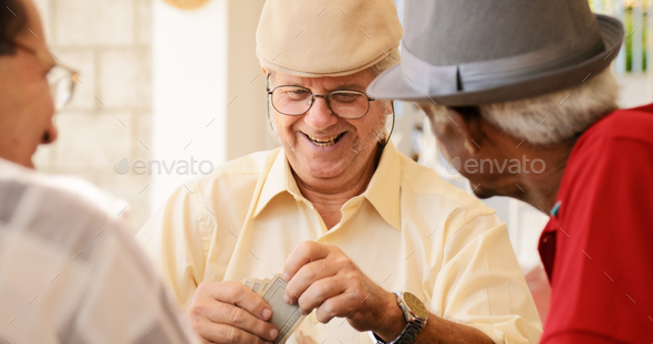 Group Of Happy Seniors Playing Cards Game - Stock Photo - Images