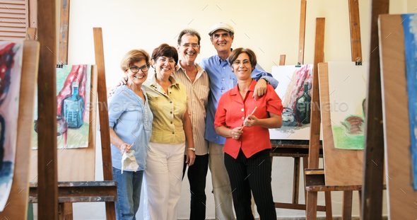 Group Portrait Of Elderly People Smiling At Art School