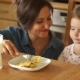 Mother Feeds Her Little Daughter The Girl Obediently Opens Her Mouth Scrambled Eggs, Healthy - VideoHive Item for Sale
