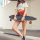young youth female with skateboard on street - PhotoDune Item for Sale