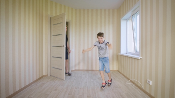 Happy Family Walking In New House Joyful Boy Opening Door