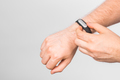Close-up of man's hand with fitness tracker over grey background - PhotoDune Item for Sale