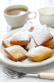 homemade new orleans beignet donuts with plenty of powdered sugar