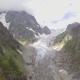 Flying Over Glacier Valley in Svaneti Rocks. Snow Peak in Caucasus, Georgia.