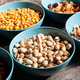Mix of different type of nuts in blue bowls - PhotoDune Item for Sale