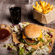 Delicious home made burgers on wooden plate next to a glass of c - PhotoDune Item for Sale