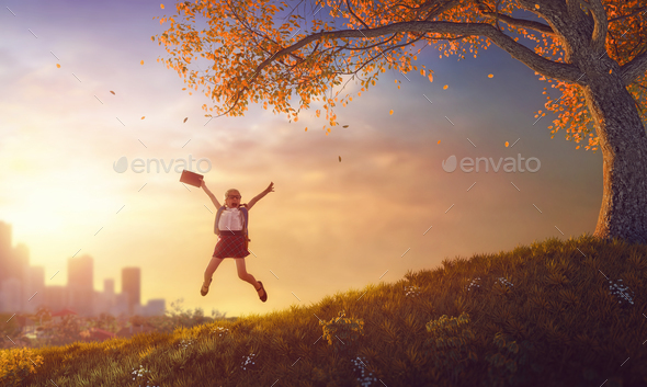 child jumping with book