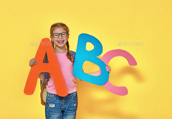 child with big letters
