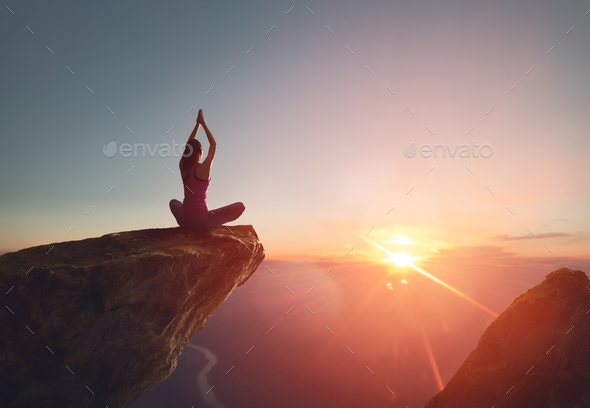 Woman practices yoga - Stock Photo - Images