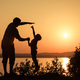 father and son playing on the coast of lake - PhotoDune Item for Sale