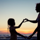 Mother and daughter playing on the beach at the sunset time. - PhotoDune Item for Sale