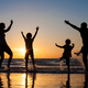 Silhouette of happy family who playing on the beach at the sunse - PhotoDune Item for Sale