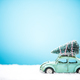 Vintage toy car carry Christmas tree in snow - PhotoDune Item for Sale