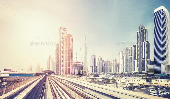 Color toned panoramic picture of Dubai skyline, UAE.