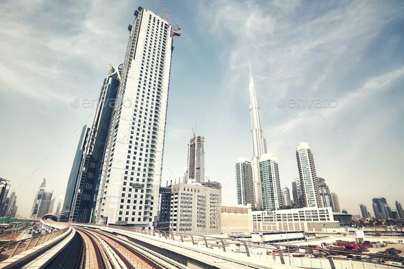Retro color toned wide angle view of Dubai skyline, UAE.