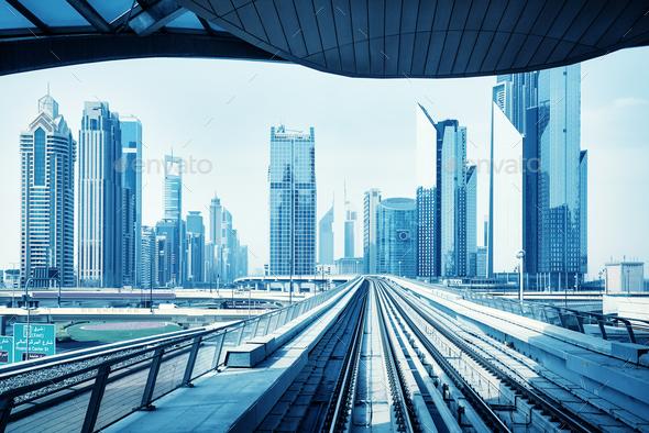 Futuristic Dubai skyline, blue color toning.