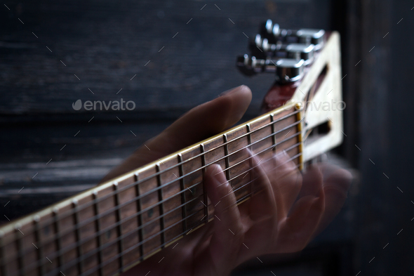 fingers on guitar dark background - Stock Photo - Images