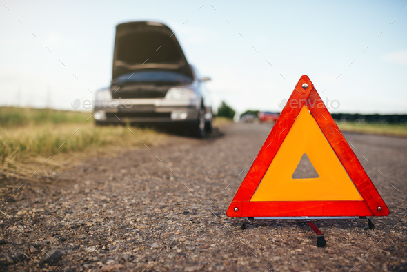 Broken car concept, breakdown triangle on road - Stock Photo - Images