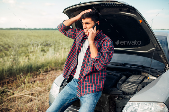 Man calls to service, trouble with vehicle - Stock Photo - Images
