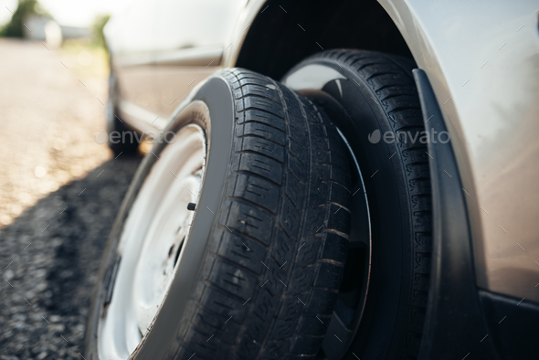 Broken car concept, spare wheel replacement - Stock Photo - Images