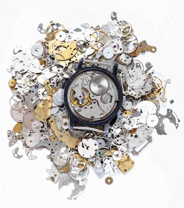 top view of mechanic watch on heap of spare parts - Stock Photo - Images