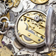 open silver pocket watch on heap of spare parts - PhotoDune Item for Sale