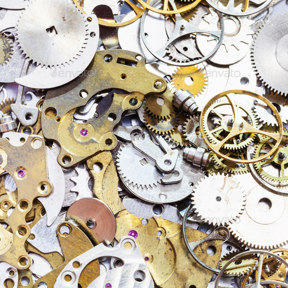 pile of old watch spare parts close up - Stock Photo - Images