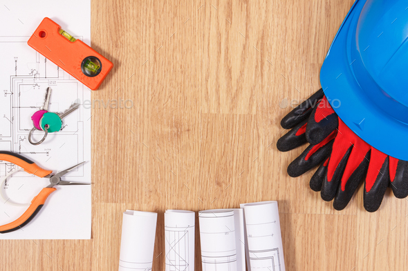Home keys with electrical drawings, protective blue helmet with gloves and orange work tools - Stock Photo - Images