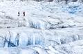 Two people trekking on ice Vatnajokull glacier