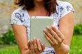 Black tablet in hands and blurred background