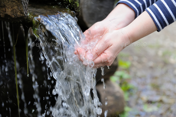 Water pouring in woman hand