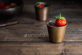 Strawberries on Rustic Table