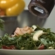 Cook's Hands Sprinkle with Pepper Salad in Kitchen - VideoHive Item for Sale
