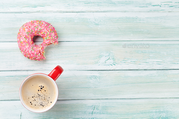 Coffee cup and donut - Stock Photo - Images