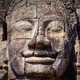 Detail of vintage stone face in the Bayan temple at Angkor Wat - PhotoDune Item for Sale