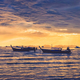 Ocean coast cloudy colorful sunset with fishing boats - PhotoDune Item for Sale