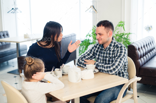 Little girl doesn't want to hear arguing of parents - Stock Photo - Images