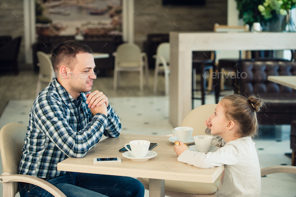 Father And Daughter Having Lunch Together At The Mall - Stock Photo - Images