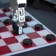 Robot Playing Checkers. Hand Manipulator Moves Checkers.
