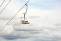 Empty chairlift with cloudy sky in the background - PhotoDune Item for Sale