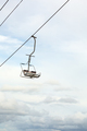 Empty chairlift with blue sky in the background - PhotoDune Item for Sale