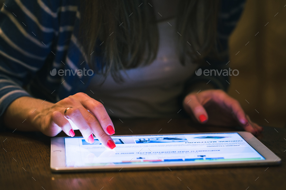 Front view of a woman using a digital tablet