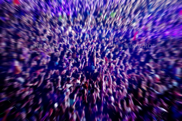 Abstract blur background of crowd of people watching concert