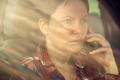 Worried woman talking on mobile phone in car - PhotoDune Item for Sale