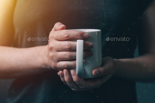 Womn drinking morning coffee