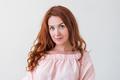 Caucasian woman model with ginger hair posing indoors - PhotoDune Item for Sale