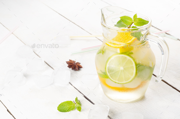 Jug with Lime and Orange Fruit Water with ice